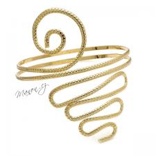 Egyptský náramek na paži s hadím tělem a spirálou
