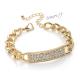 Řetízkový náramek zlaté barvy s třpytivými kamínky